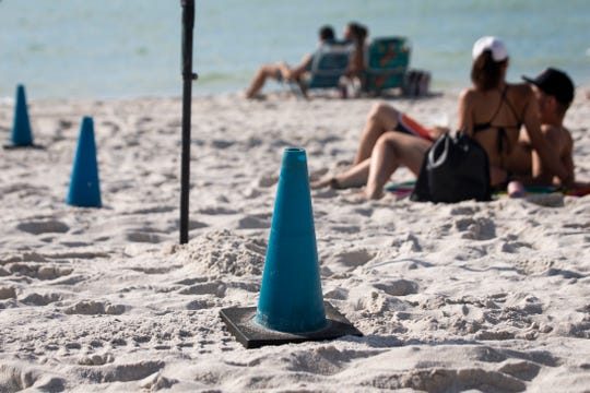 Blue cones mark the line between the public access point and Naples Beach Water Sports, which is affiliated with the Ritz-Carlton, on Tuesday, Jan. 8, 2019, at Vanderbilt Beach in North Naples.