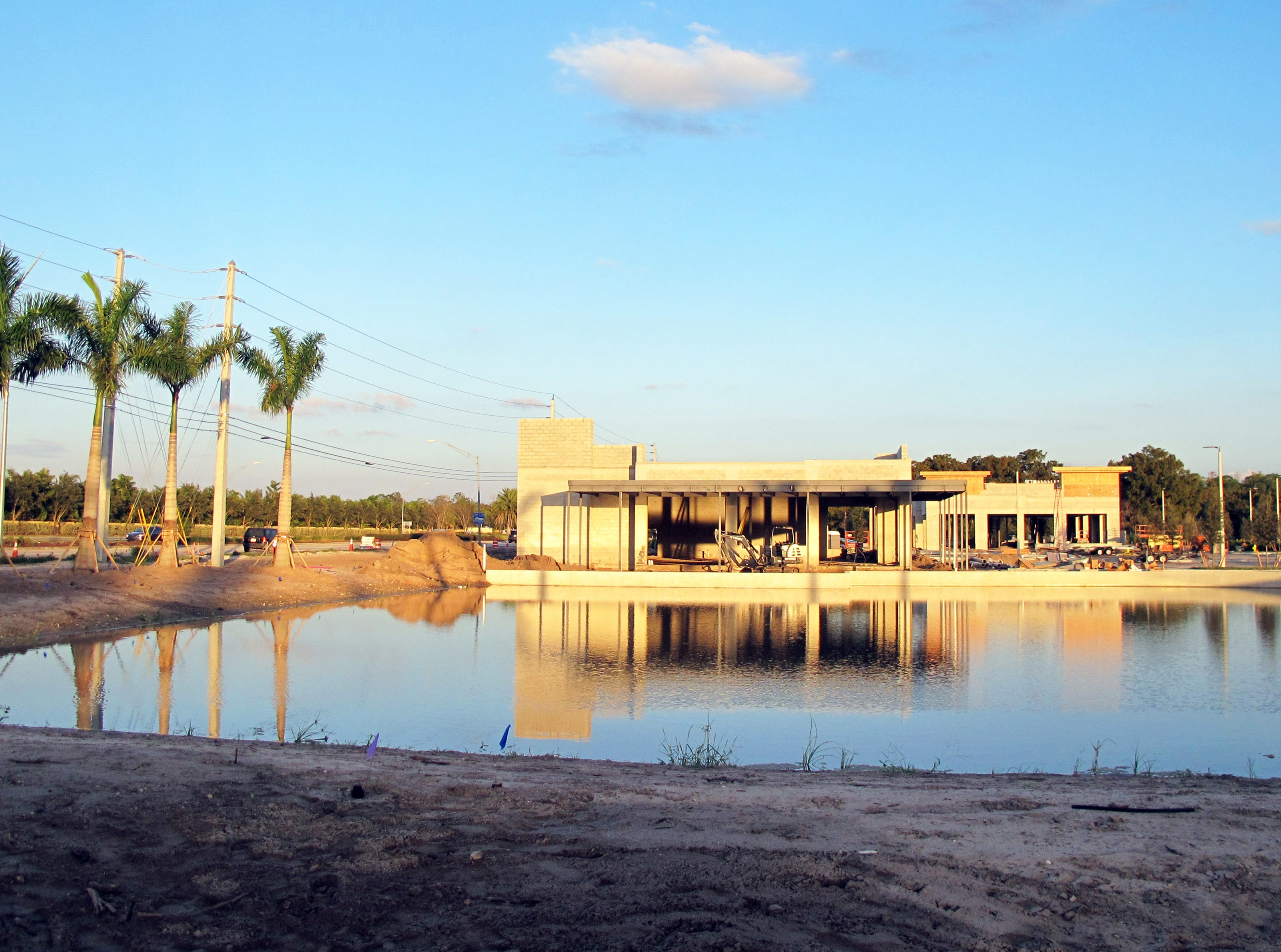 The freestanding Oak & Stone restaurant and bar will be adjacent to a water feature at the new Logan Landings retail center under construction on the southeast corner of Logan Boulevard and Immokalee Road in North Naples.