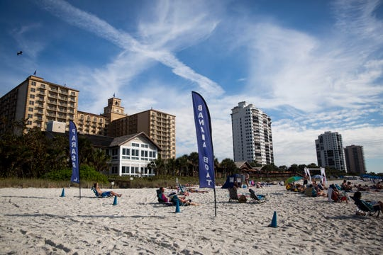 The Ritz-Carlton, which is next to the public beach access, designates most of the beach area in front of its property for use by guests only on Tuesday, Jan. 8, 2019, at Vanderbilt Beach in North Naples.
