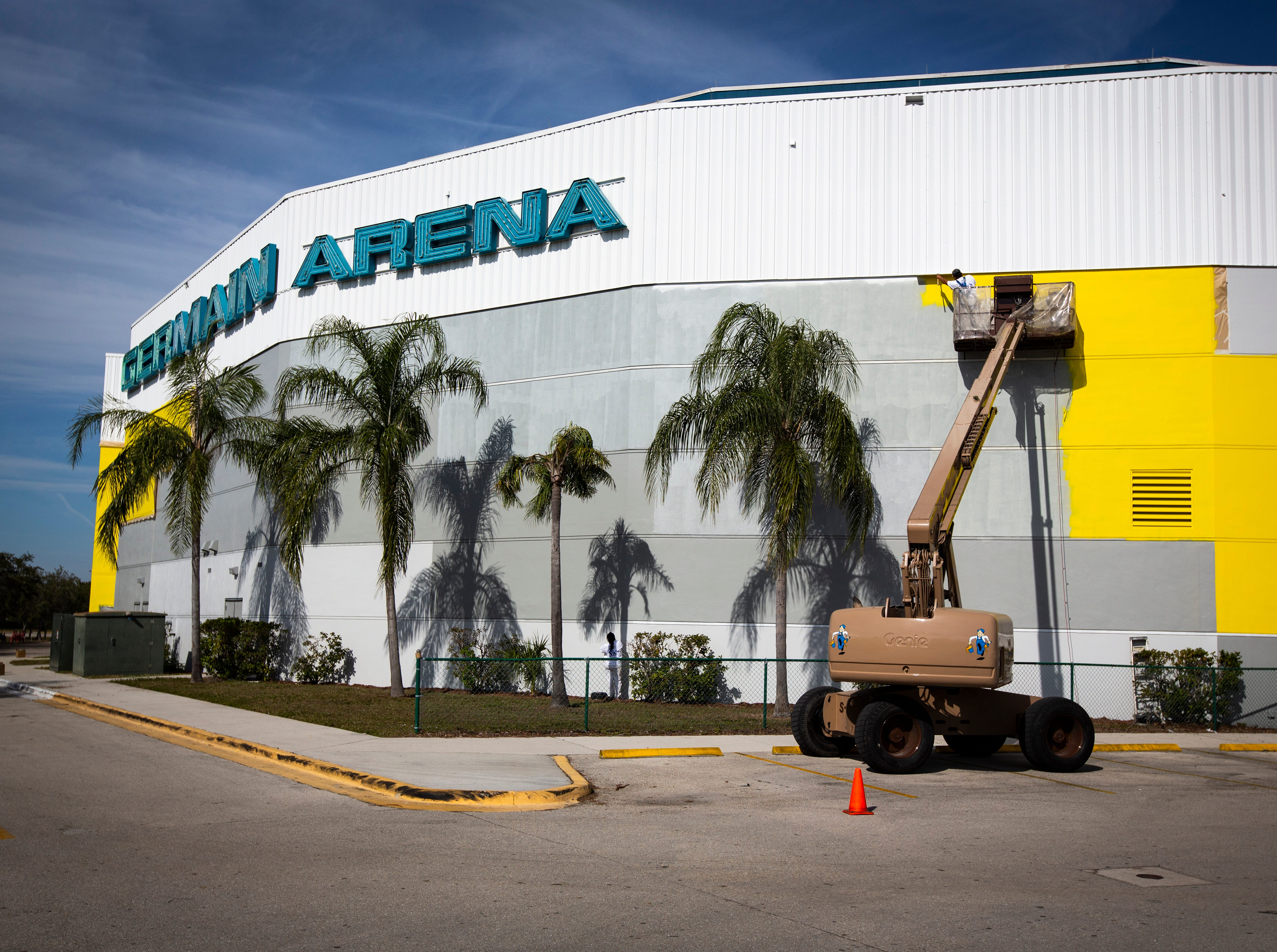 Workers from Vic's Painting & Reconstruction of Fort Myers have been working for three weeks on painting the Hertz Arena yellow and continued on Jan. 8, 2019. The Estero-based rental car giant took over the naming rights of the Germain Arena last year.