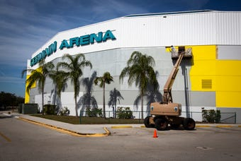 If you see something yellow out of the corner of your eye while driving on I-75, it's just Hertz Arena. It is in the process of being painted yellow.