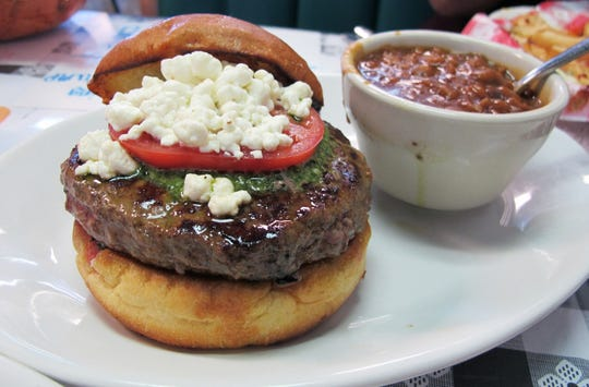 The Pesto & Goat Cheese burger is one of the favorites at Brooks Gourmet Burgers and Dogs. A fourth location is opening in 2019 in North Naples.