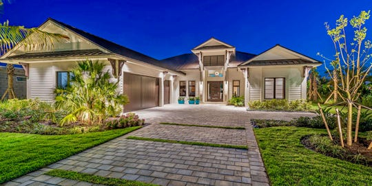 Award-winning Newport model is located in the resort-style community of Naples Reserve.