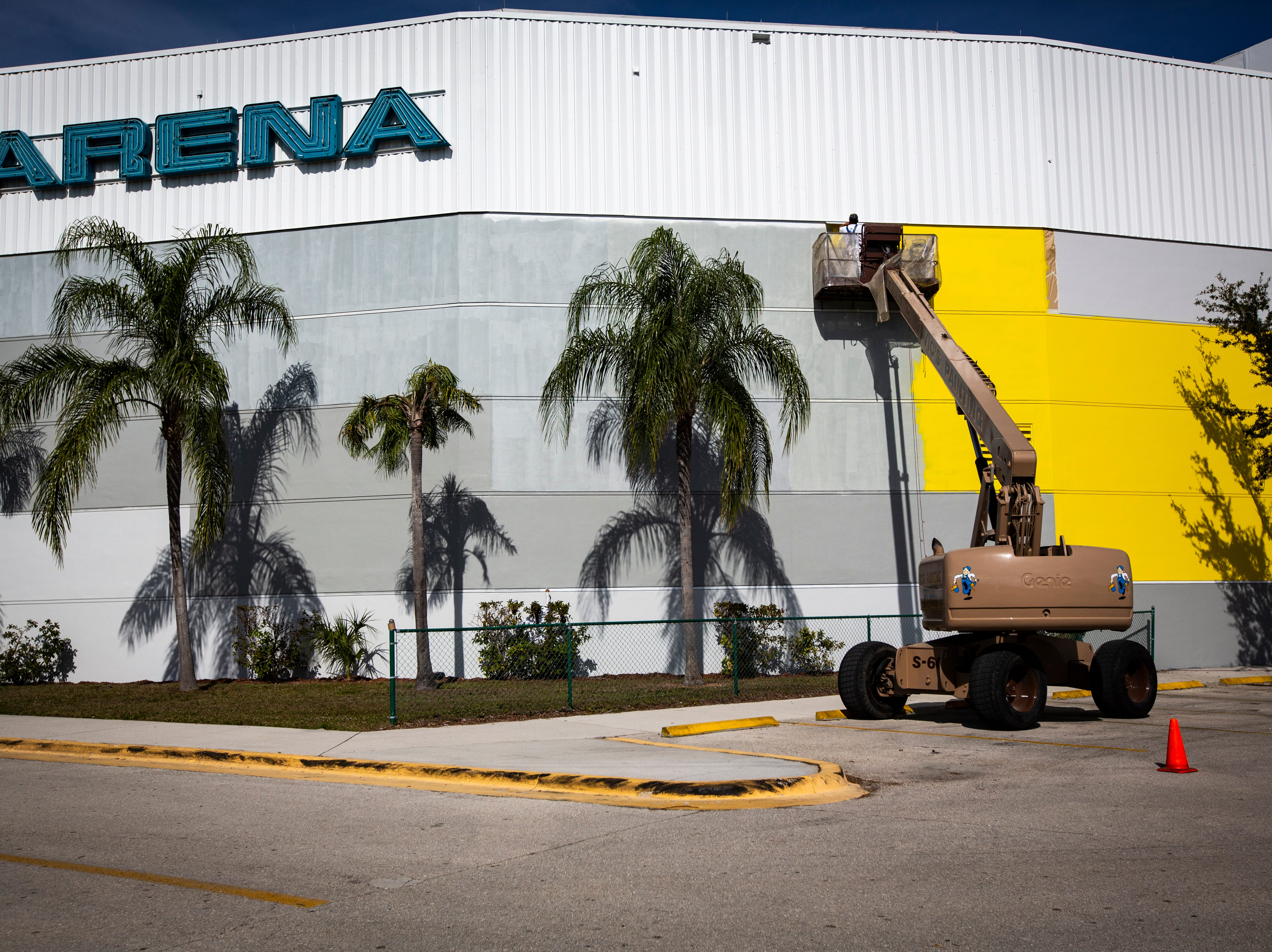 Workers from Vic's Painting & Reconstruction of Fort Myers have been working for three weeks on painting the Hertz Arena yellow and continued their work on Jan. 8, 2019. The Estero-based rental car giant took over the naming rights of the Germain Arena last year.