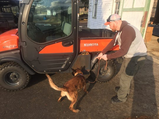 Training with partner John Dailey, Granville K-9 Officer Moke makes a successful discovery of drugs hidden in a vehicle compartment during Bryn Du training Jan. 8.