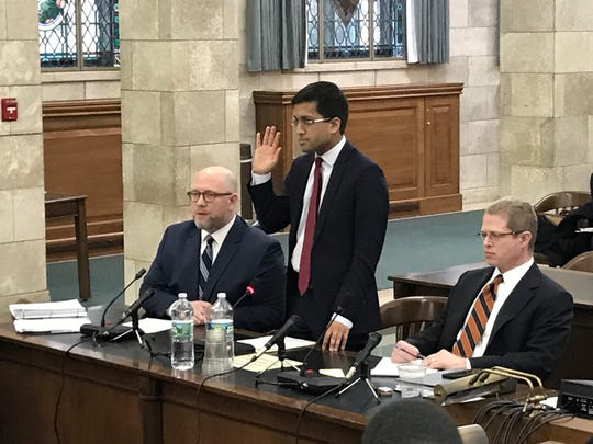 Parimal Garg, deputy chief counsel to Gov. Phil Murphy, is sworn in ahead of testimony in front of the Select Oversight Committee in the Statehouse on Jan. 8, 2019.