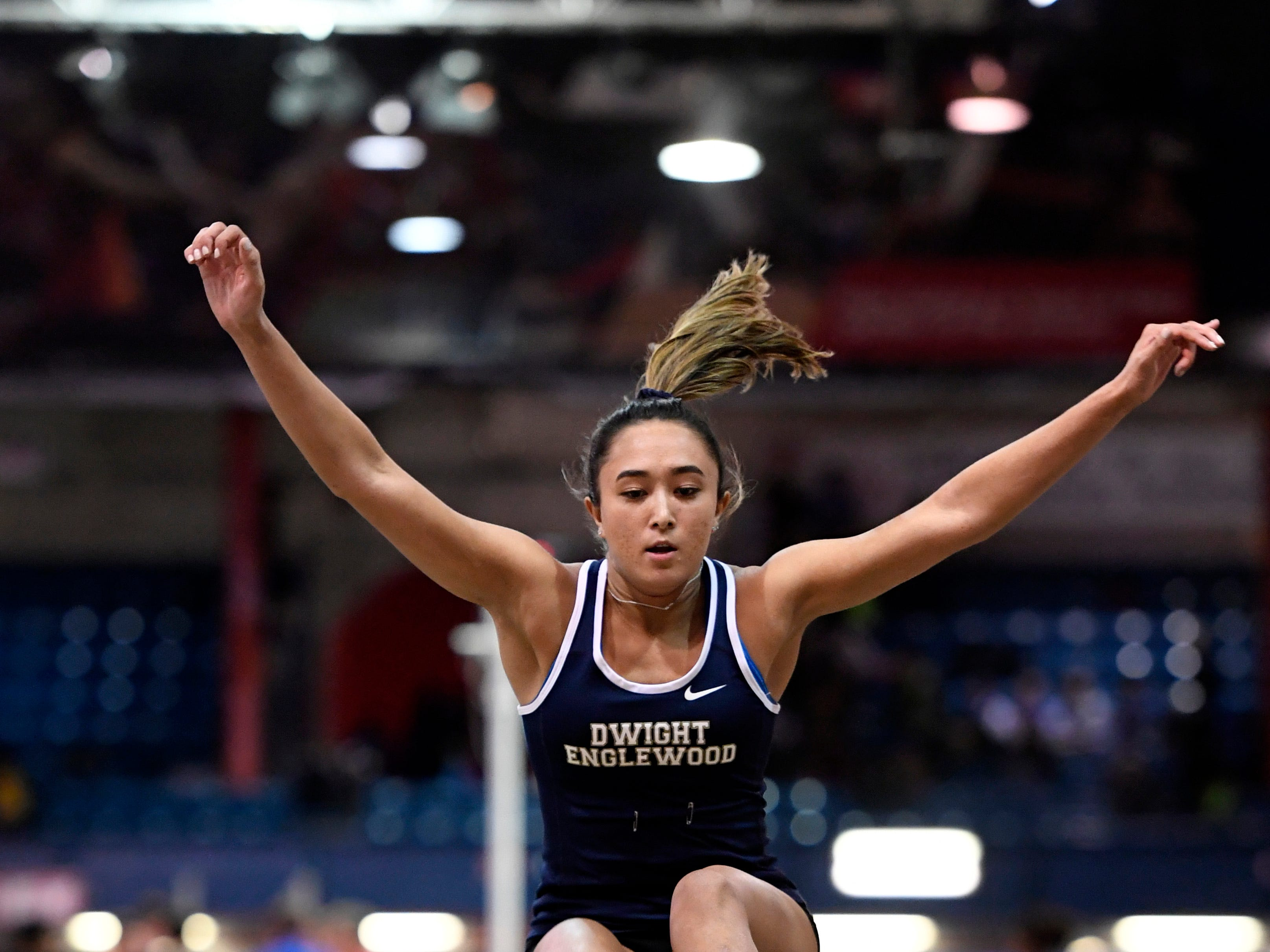 Caroline Lee of Dwight Englewood competes in the long jump during the NJIC track meet at the Armory Track on Monday, Jan. 7, 2019, in New York.