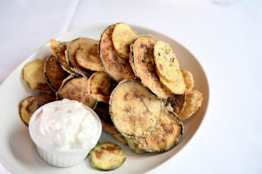 Lefkes crisps, which are crispy zucchini and eggplant chips, served with tzatziki at Lefkes Estiatorio on Tuesday, Jan. 8, 2019, in Englewood Cliffs.