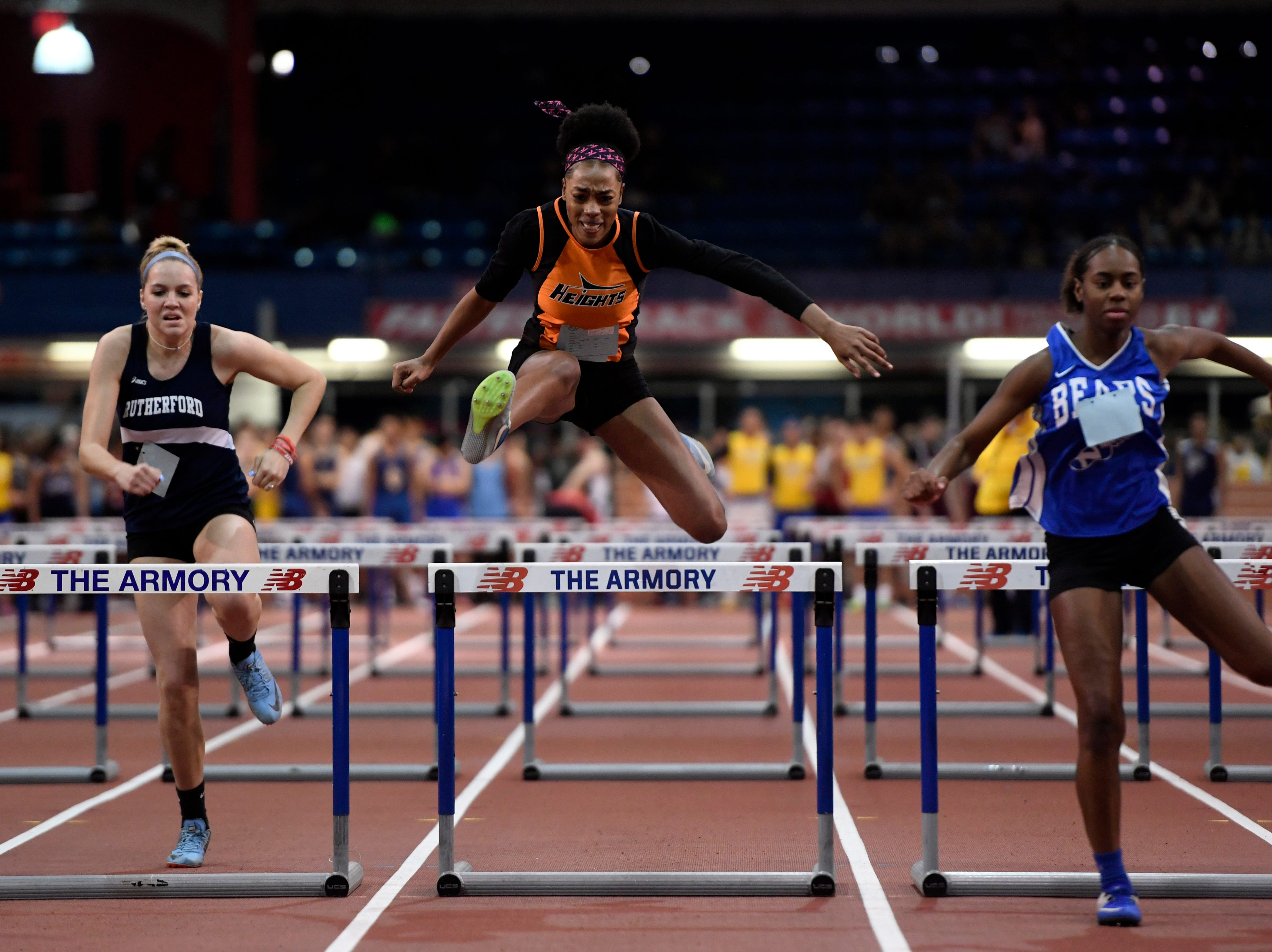 Talia Ferguson of Hasbrouck Heights (center) competes in the 55-meter hurdles during the NJIC track meet at the Armory Track on Monday, Jan. 7, 2019, in New York.