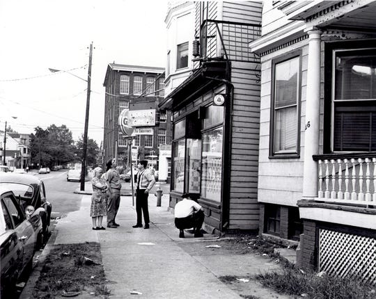PATERSON,NJ   June 17,1966  RUBIN HURRICANE CARTER:  Police and on-lookers in front of the Lafayette Bar the morning after the shooting .