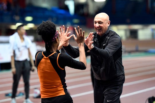 Hasbrouck Heights coach John d'Amato high-fives Talia Ferguson after Ferguson clears 5-feet-2-inches in the high jump during the NJIC track meet at the Armory Track on Monday, Jan. 7, 2019, in New York.