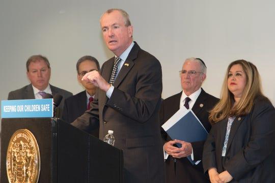 Gov. Phil Murphy speaks before signing school security funding bill.