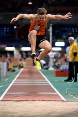 Adam Stavash of Hasbrouck Heights competes in the triple jump during the NJIC track meet at the Armory Track on Monday, Jan. 7, 2019, in New York.