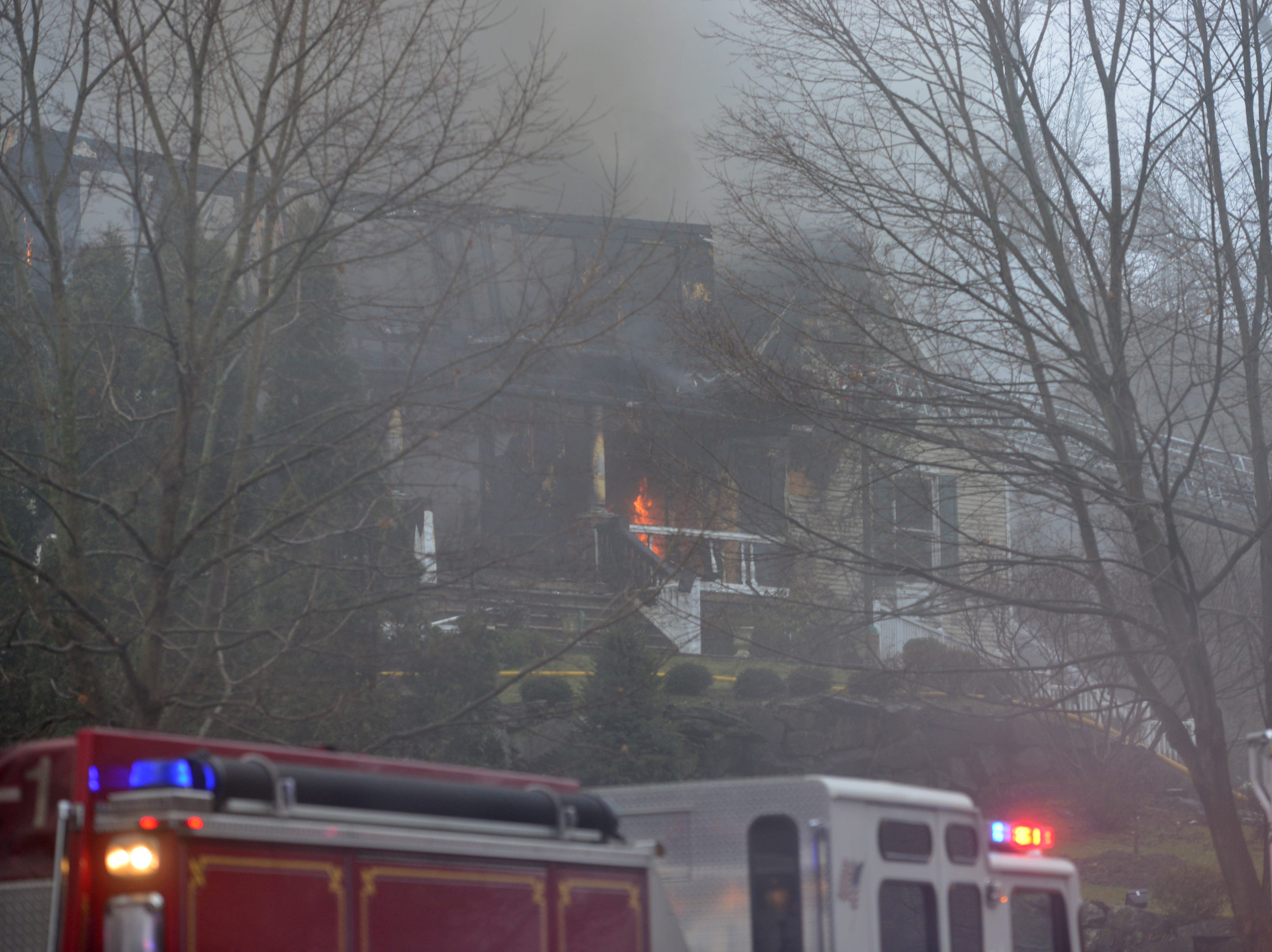 A fire rages at a home on Skyview Rd in Wayne, on Tuesday January 8, 2019.