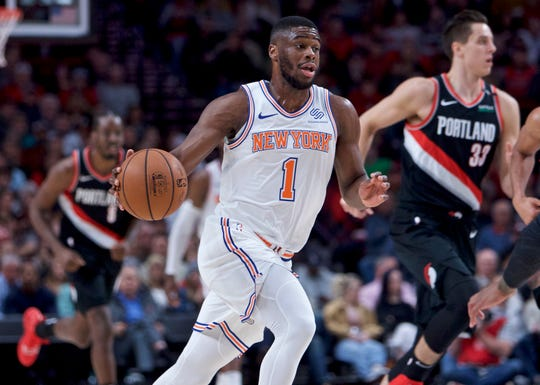 New York Knicks guard Emmanuel Mudiay (1) brings the ball upcourt against the Portland Trail Blazers during the first half of an NBA basketball game in Portland, Ore., Monday, Jan. 7, 2019. (AP Photo/Craig Mitchelldyer)