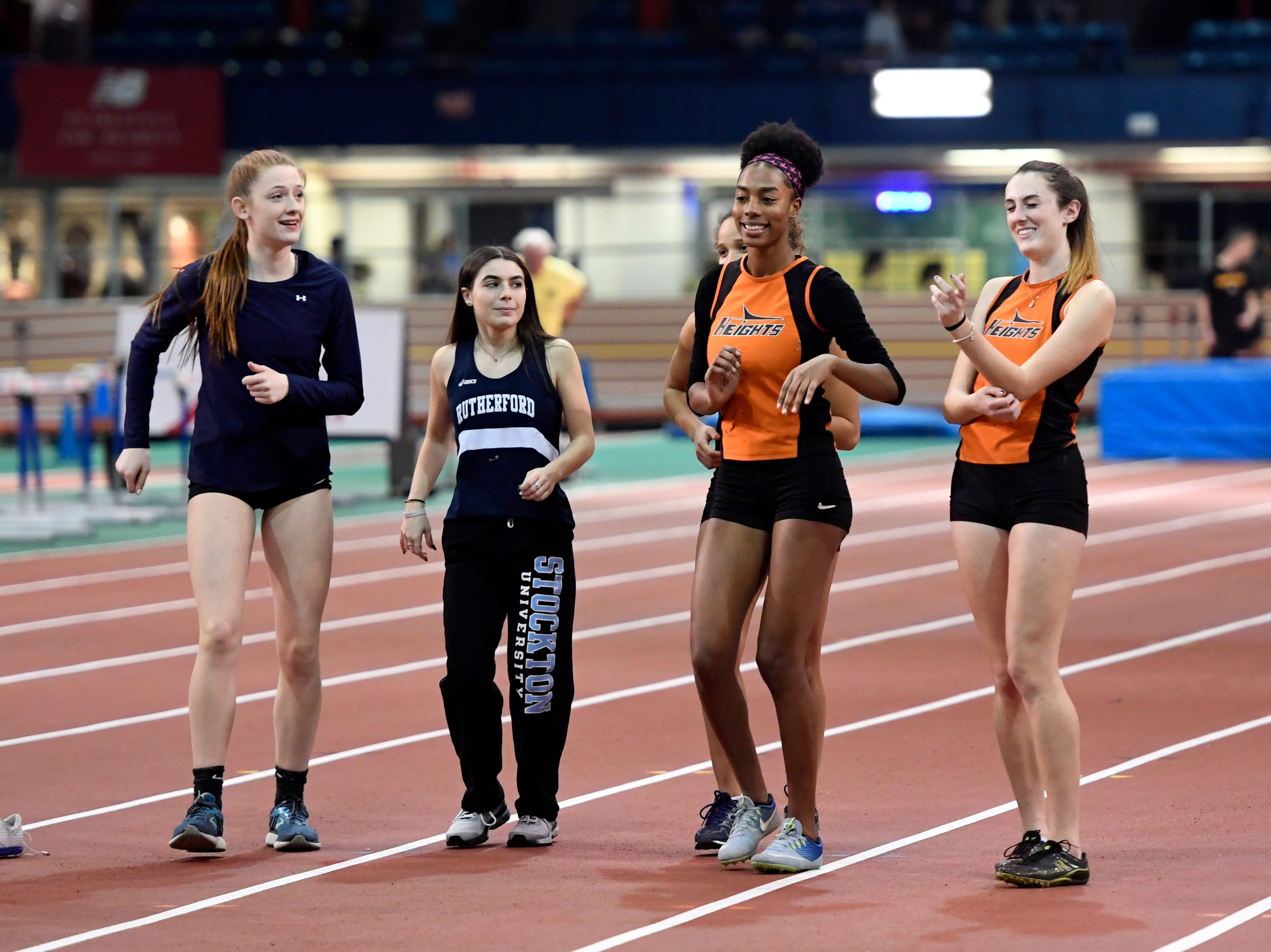 Rutherford and Hasbrouck Heights athletes dance in between heats during the NJIC track meet at the Armory Track on Monday, Jan. 7, 2019, in New York.