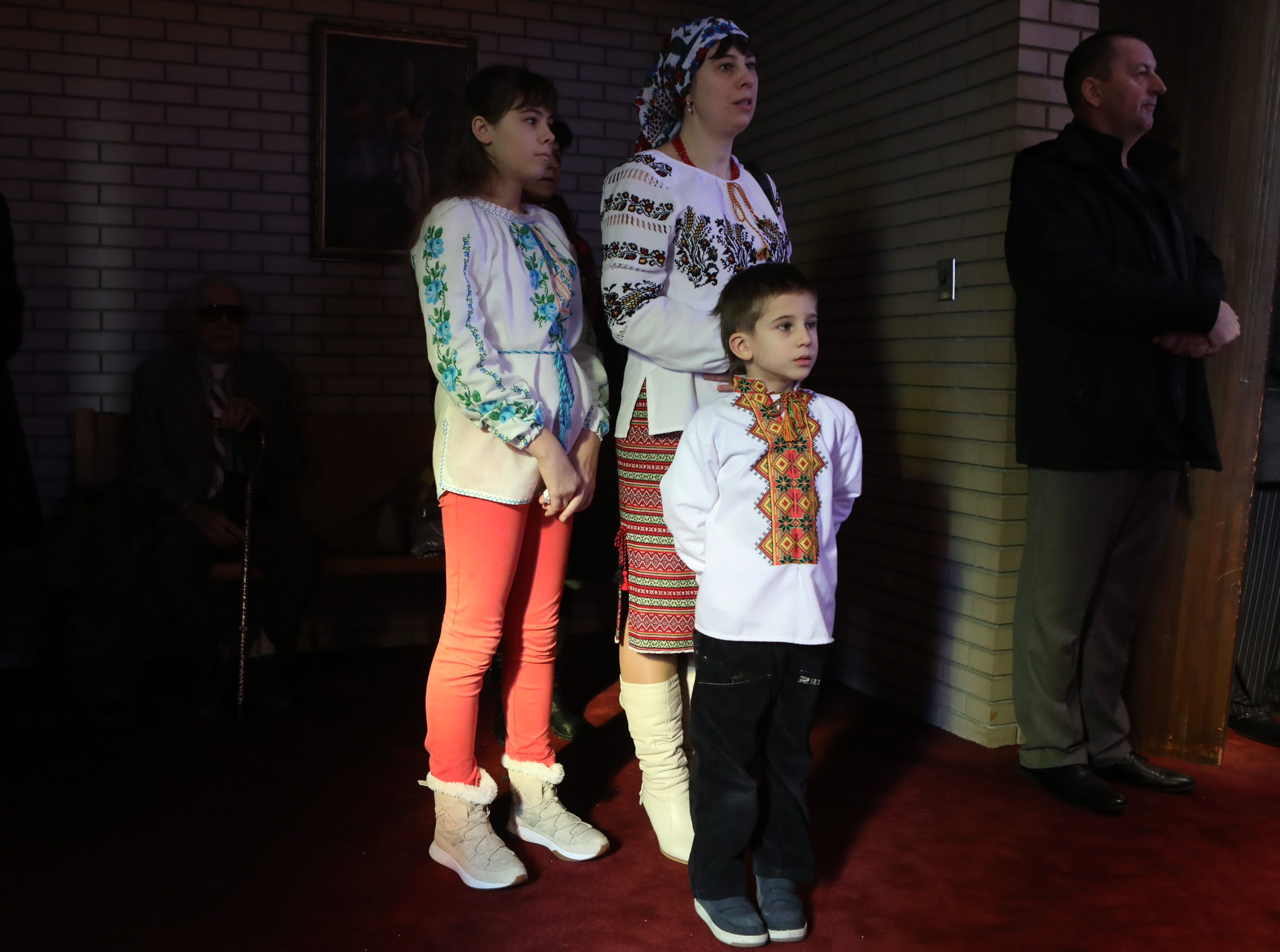 Nataliia Holchuk stands with her children, Marharyta Holchuk, 12, and Olekjii Holchuk, 5, at the Ukrainian Orthodox Holy Ascension Church, in Clifton. Monday, January 7, 2019