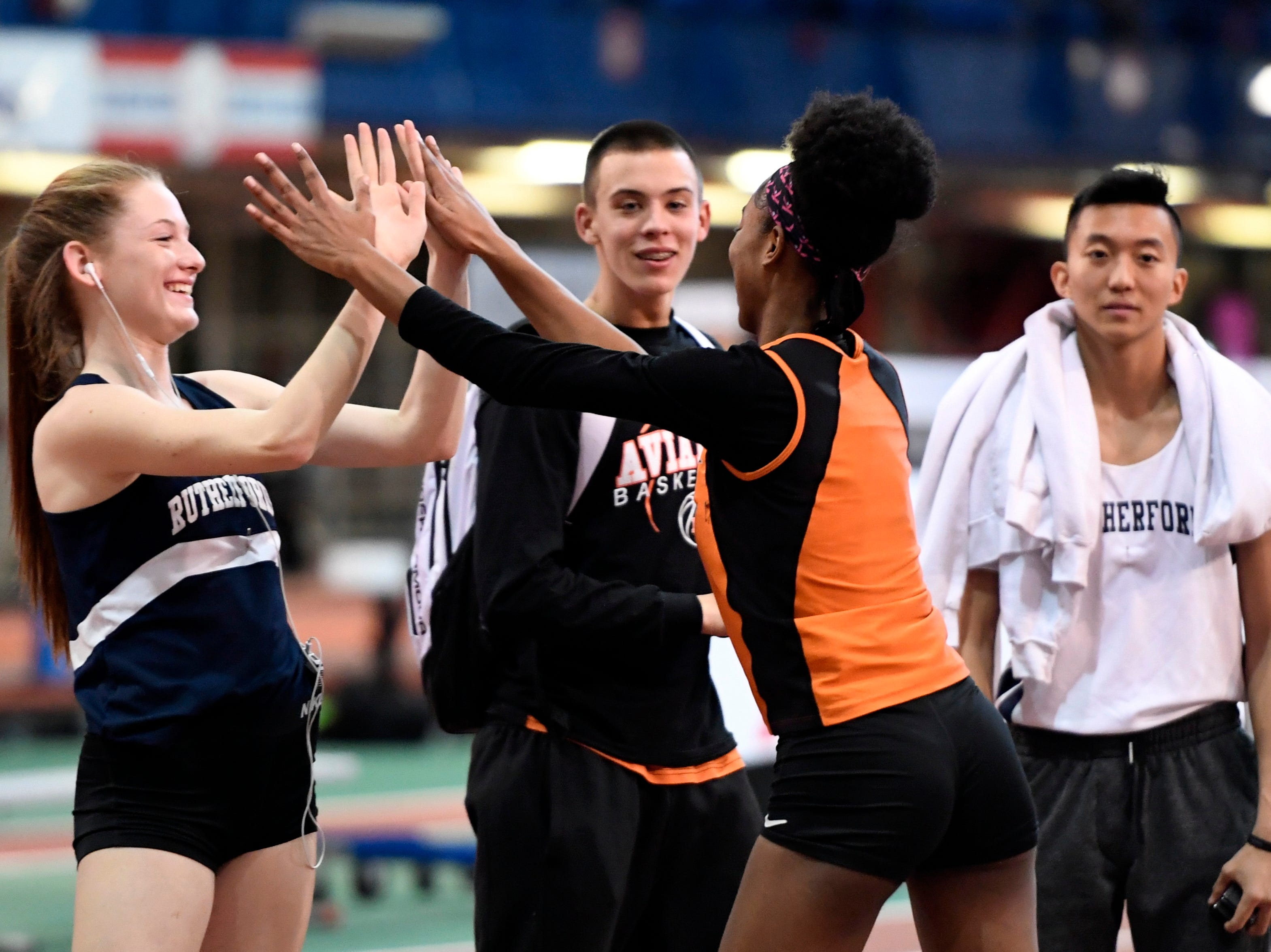Rutherford's Jenna Rogers, left, high-fives Hasbrouck Heights' Talia Ferguson after Ferguson clears 5-feet-2-inches in the high jump during the NJIC track meet at the Armory Track on Monday, Jan. 7, 2019, in New York.