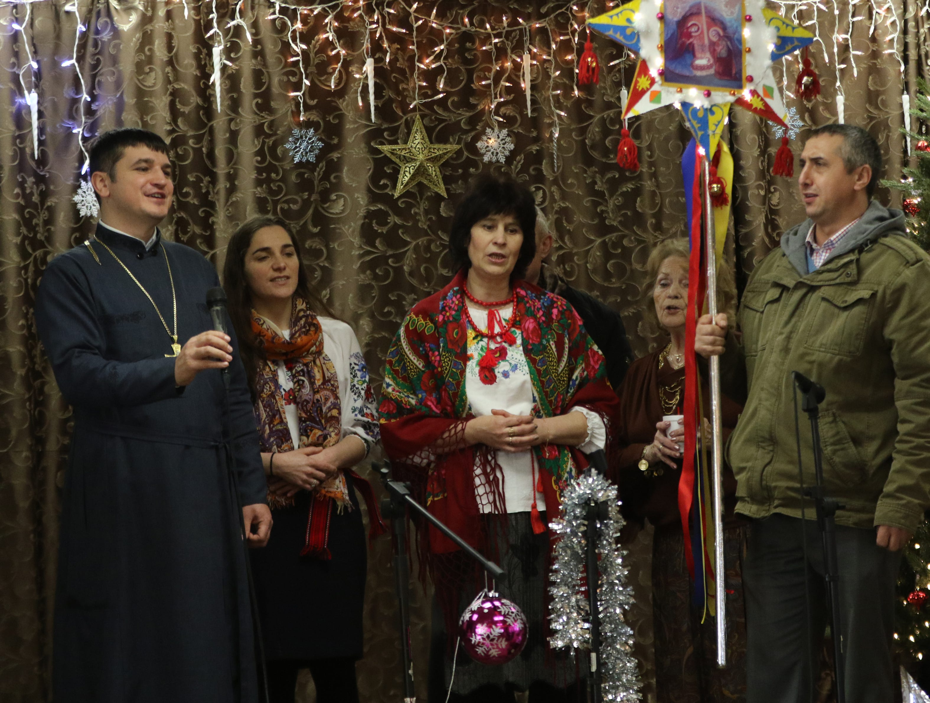 Father Oleksii Holchuk, and others sing hymns downstairs after the Divine Liturgy.  Monday, January 7, 2019