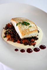 The roasted halibut, served with cauliflower puree and beluga lentil salad, at Lefkes Estiatorio on Tuesday, Jan. 8, 2019, in Englewood Cliffs.