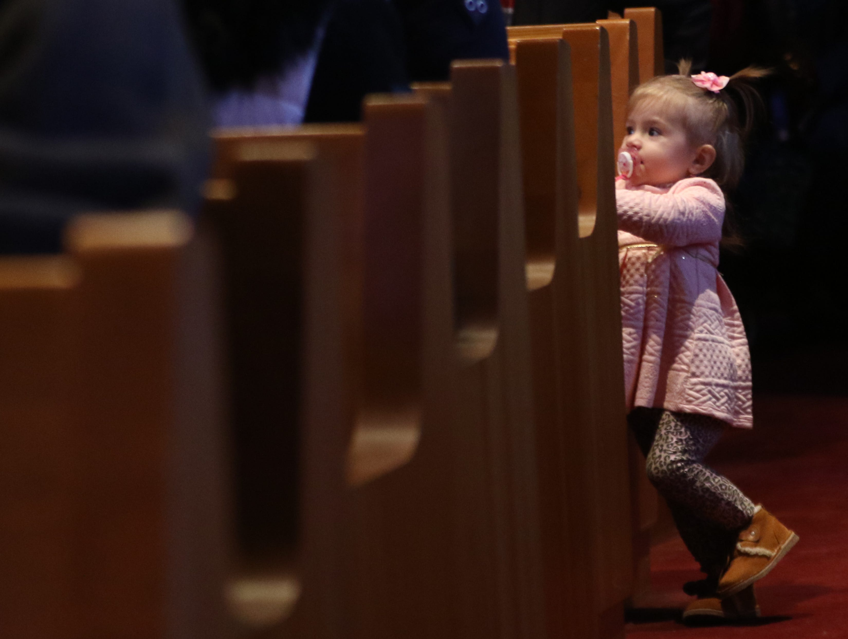 Anastasia Roschis-Levytska, 14 months-old, is shown as she heads to the pew at the Ukrainian Orthodox Holy Ascension Church. Monday, January 7,  2019