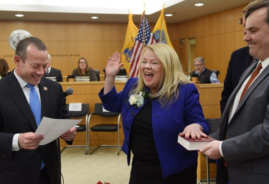 Mary Amoroso is sworn in as Vice-Chairwoman by Congressman Josh Gottheimer as the members of her family looks on during the annual Bergen County freeholder board's reorganization meeting at Bergen County Plaza in Hackensack on 01/07/19.