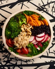 This bowl from Sprout includes shredded chicken, carrots, broccoli, cherry tomatoes and more.