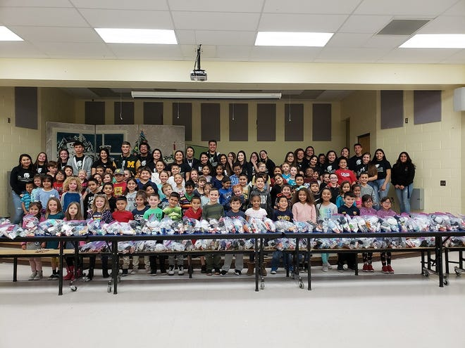 Students from Hillrise Elementary School and students from the ENLACE Program at Mayfield High School finish assembling Blessing Bags for the homeless. 2018 marked the fourth year of the community service project.
