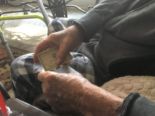 Albert Rel, 94, still carries two enlistment cards - for the U.S. Navy in 1941 and the U.S. Army in 1951 - in his wallet. They are slightly worn but still crisp. At Rel's home in Las Cruces, Monday, Jan. 7, 2019/