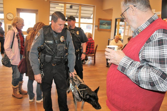 K-9 Sgt. Chris Hughs takes K-9 Officer Covi to meet Optimist Club of Alamogordo President John Cowart during Coffee with a Cop. The Optimist Club sponsored the event.