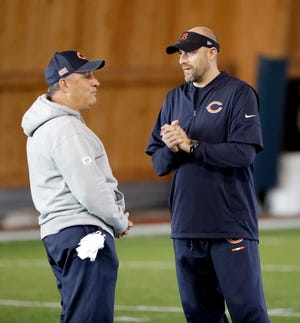 Chicago Bears head coach Matt Nagy, right, listens to defensive coordinator Vic Fangio during the NFL football team's voluntary veteran minicamp Thursday, April 19, 2018, in Lake Forest, Ill. (AP Photo/Nam Y. Huh)