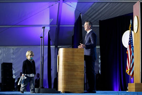 SACRAMENTO, CA - JANUARY 07: Governor Gavin Newsom delivers his inaugural address as his son Dutch, 2, walks on stage on January 7, 2019 in Sacramento, California. Gavin Newsom will begin his first term after serving as the 42nd Mayor of San Francisco as well as Lieutenant Governor of California since 2010 alongside outgoing governor Jerry Brown.
