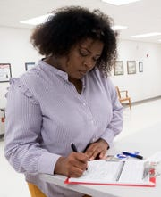 Pensacola resident, Tranassa White, registers to vote at the Escambia County Supervisor of Election Office on Tuesday, Jan. 8, 2019. White joins others across the state in signing up to vote, after having their voting rights restored, following the passage of Amendment 4 last November.