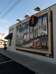 Brew Ha Ha is well-known for its large postcard mural painted outside the restaurant at 2435 N. 12th Ave. The restaurant is closing its doors and auctioning off its large collection of Pensacola-themed memorabilia.