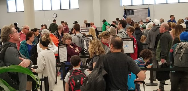 Security checkpoint lines were backed up at the Pensacola International Airport around noon on Saturday, Jan. 5, 2018.