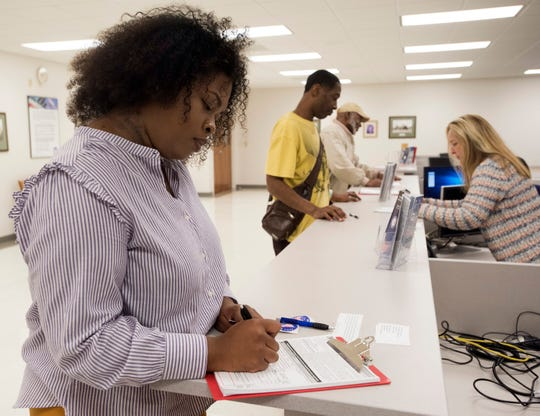 Pensacola resident Tranassa White registers to vote at the Escambia County Supervisor of Elections Office on Jan. 8. White saw her voting rights restored after voters passed Amendment 4 in November.