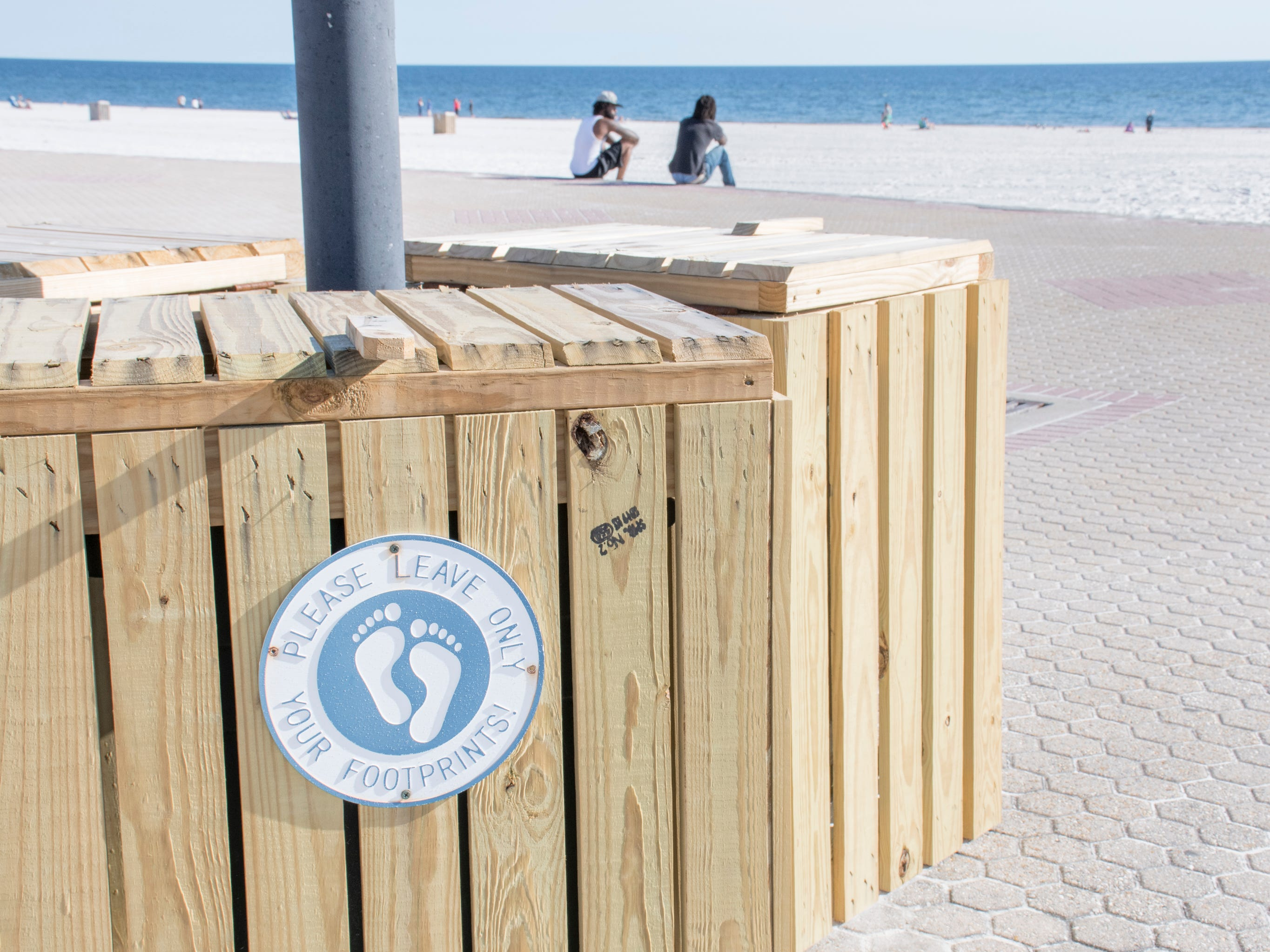 Garbage can signs remind people not to litter along Casino Beach in Pensacola on Tuesday, January 8, 2019.  The Florida Legislature is proposing a bill that would ban smoking on all beaches in the state.