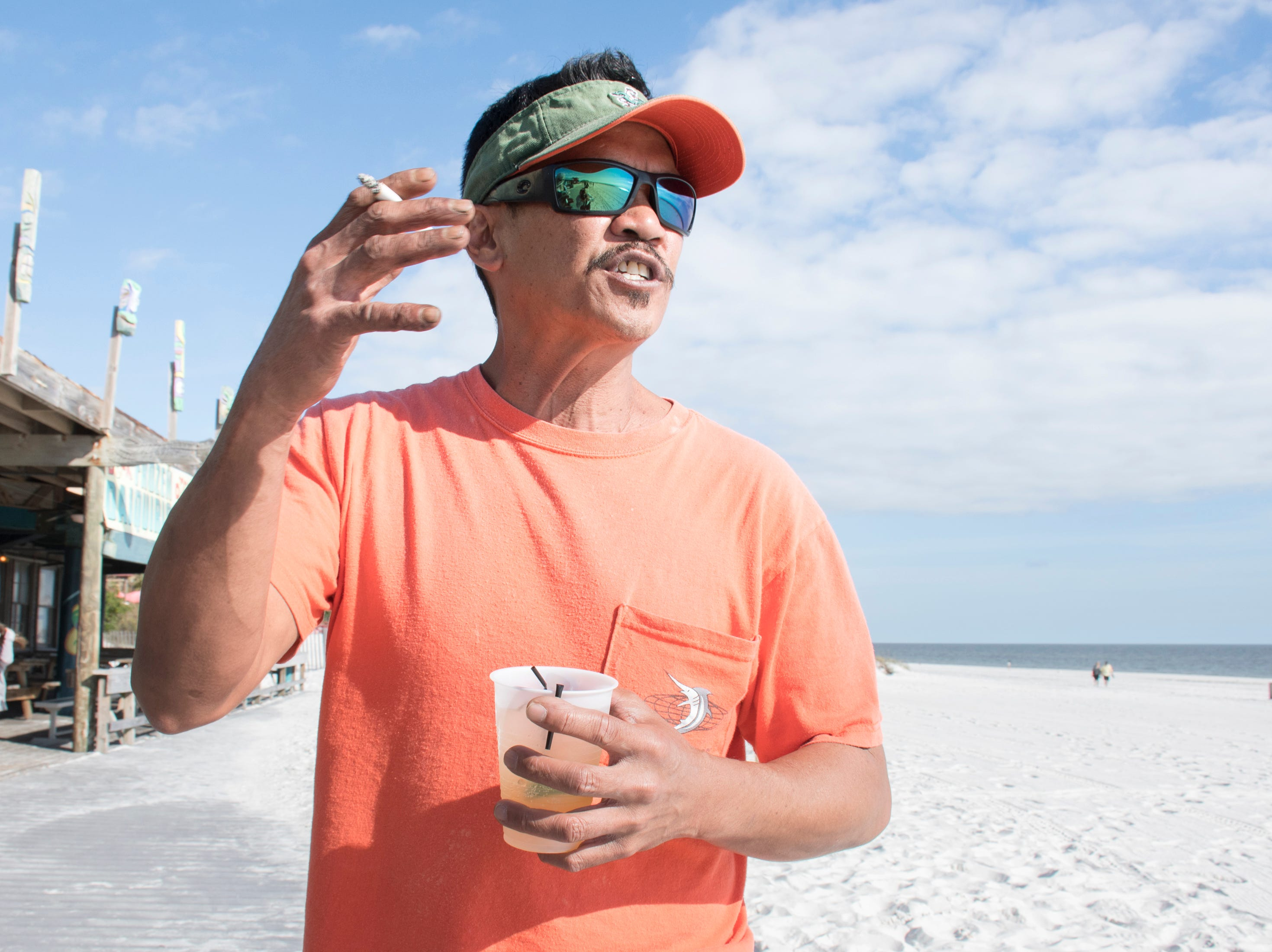 Reggy Gutierrez discusses his views about smoking at the beach in Pensacola on Tuesday, January 8, 2019.  The Florida Legislature is proposing a bill that would ban smoking on all beaches in the state.