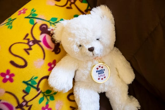 "Lola received this stuffed bear from the Make A Wish Foundation. She named the bear ""Care Bear."""