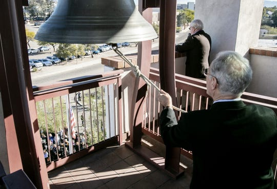 Mayor Jonathan Rothschild rings the fire tower bell while former U.S. Rep. Ron Barber reads the names of the Jan. 8, 2011, shooting victims during a commemoration at Tucson Fire Central on Jan. 8, 2019, in Tucson. The event marks the eighth anniversary of the attack in which six people were killed and 13 people were injured, including former U.S. Rep. Gabby Giffords. This is the first year that names have been read during the event.