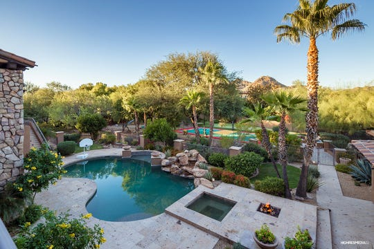 This Paradise Valley mansion purchased by Michael Beauchat includes a pool, spa, waterfalls, fire pit and sport court.