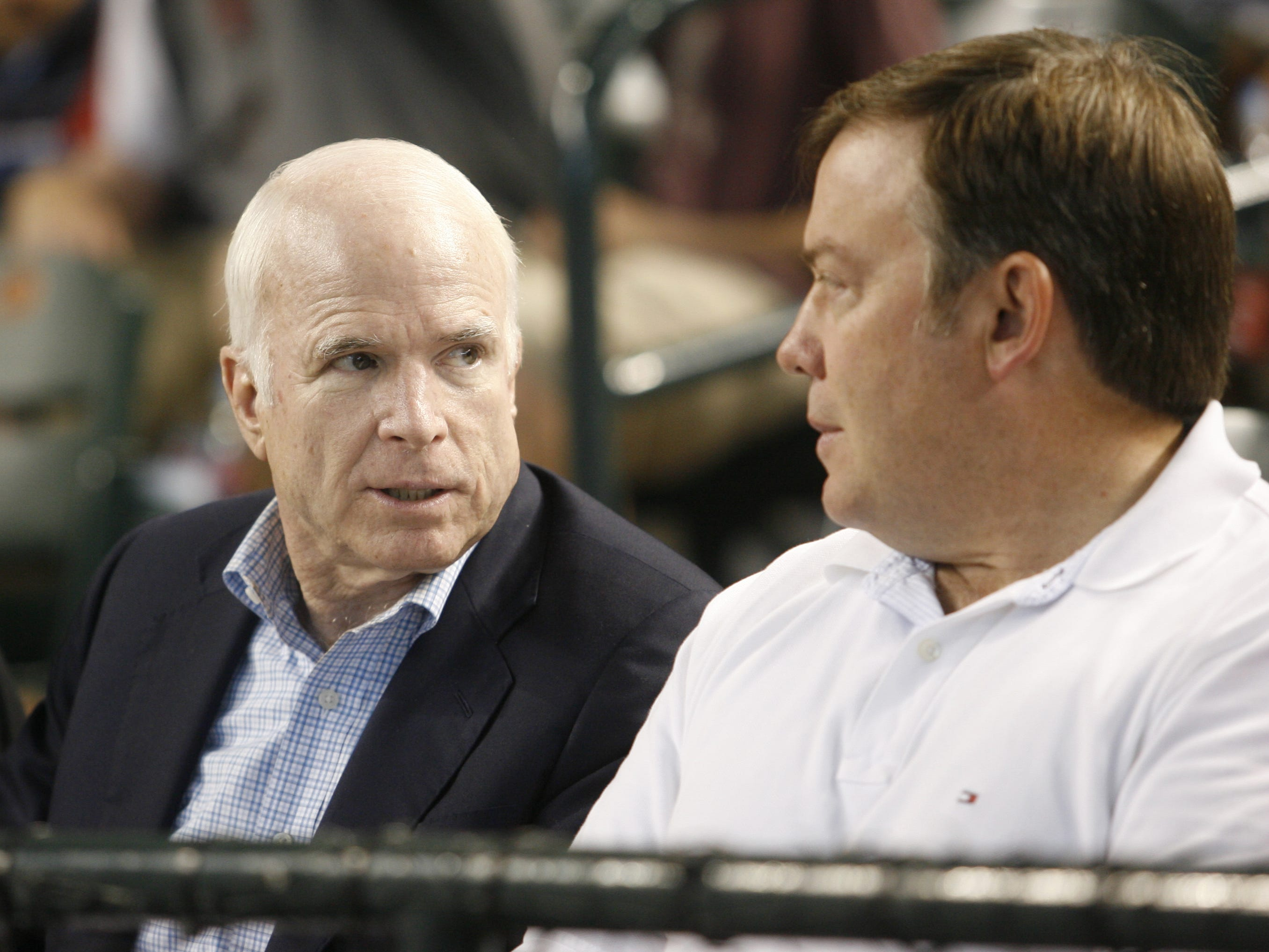 Former Arizona Sen. John McCain (left) chats with Michael Crow at an 2008 Arizona Diamondbacks game at Chase Field.