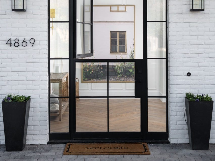 This Arcadia area house purchased by David Hadden features a custom-built steel Dutch entryway door.