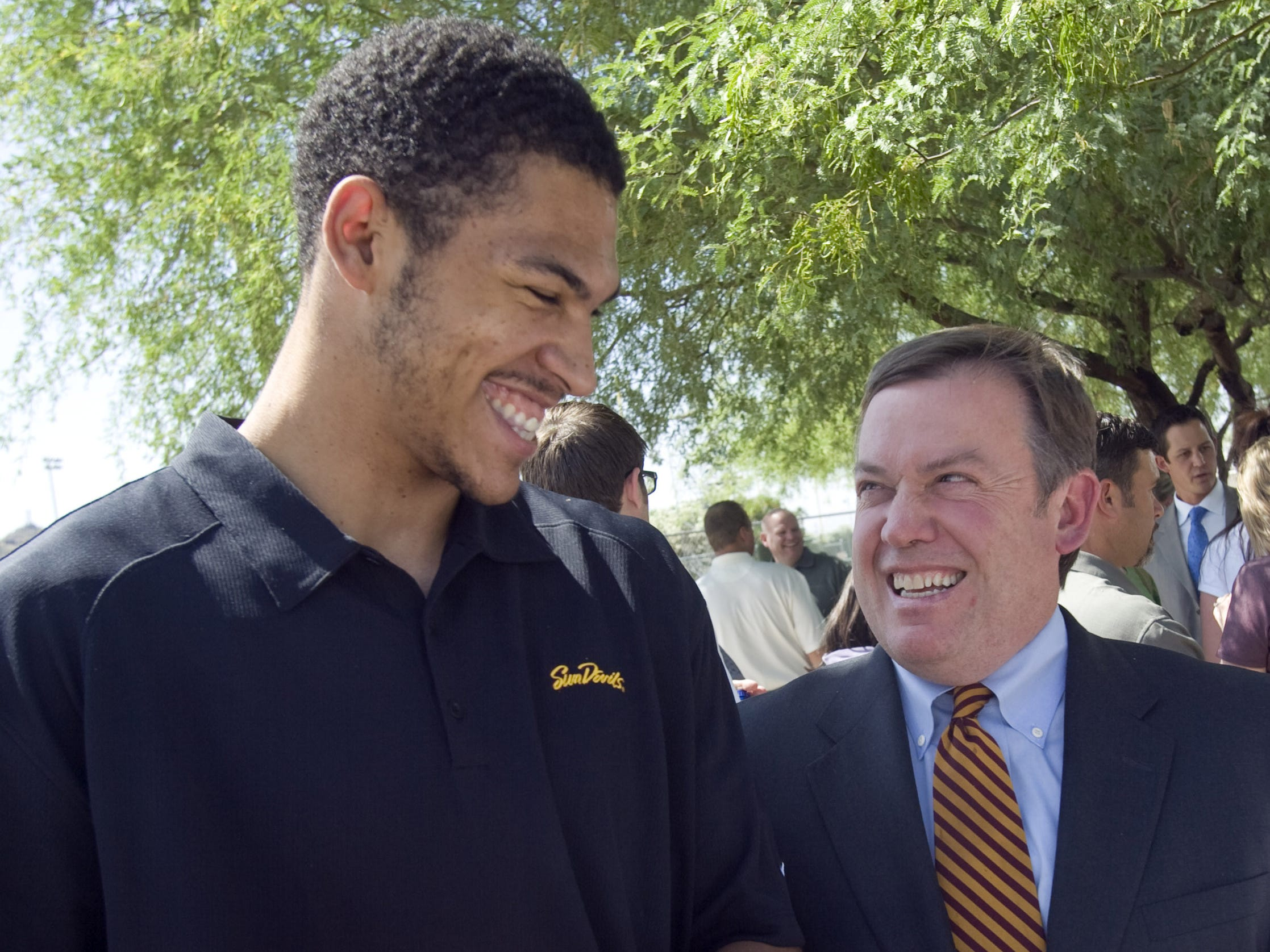 Former ASU basketball player Jeff Pendergraph (left) and ASU President Michael Crow share a laugh during the 2008 groundbreaking for the Weatherup Basketball Center at ASU's Tempe campus.