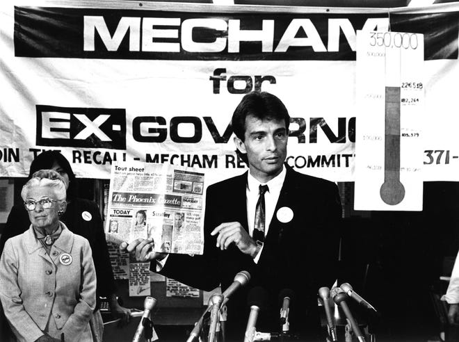 Ed Buck holds up The Phoenix Gazette at a news conference in September 1987 during the fight to recall Gov. Evan Mecham