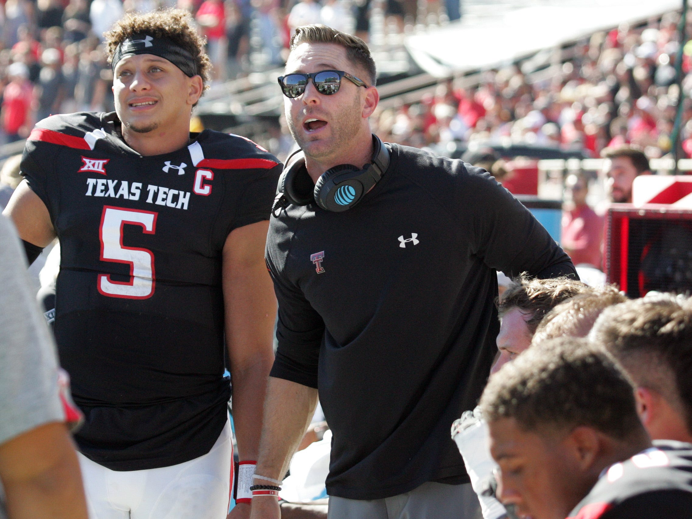 Texas Tech head coach Kliff Kingsbury and quarterback Patrick Mahomes watch a replay on the video board during a game against West Virginia.