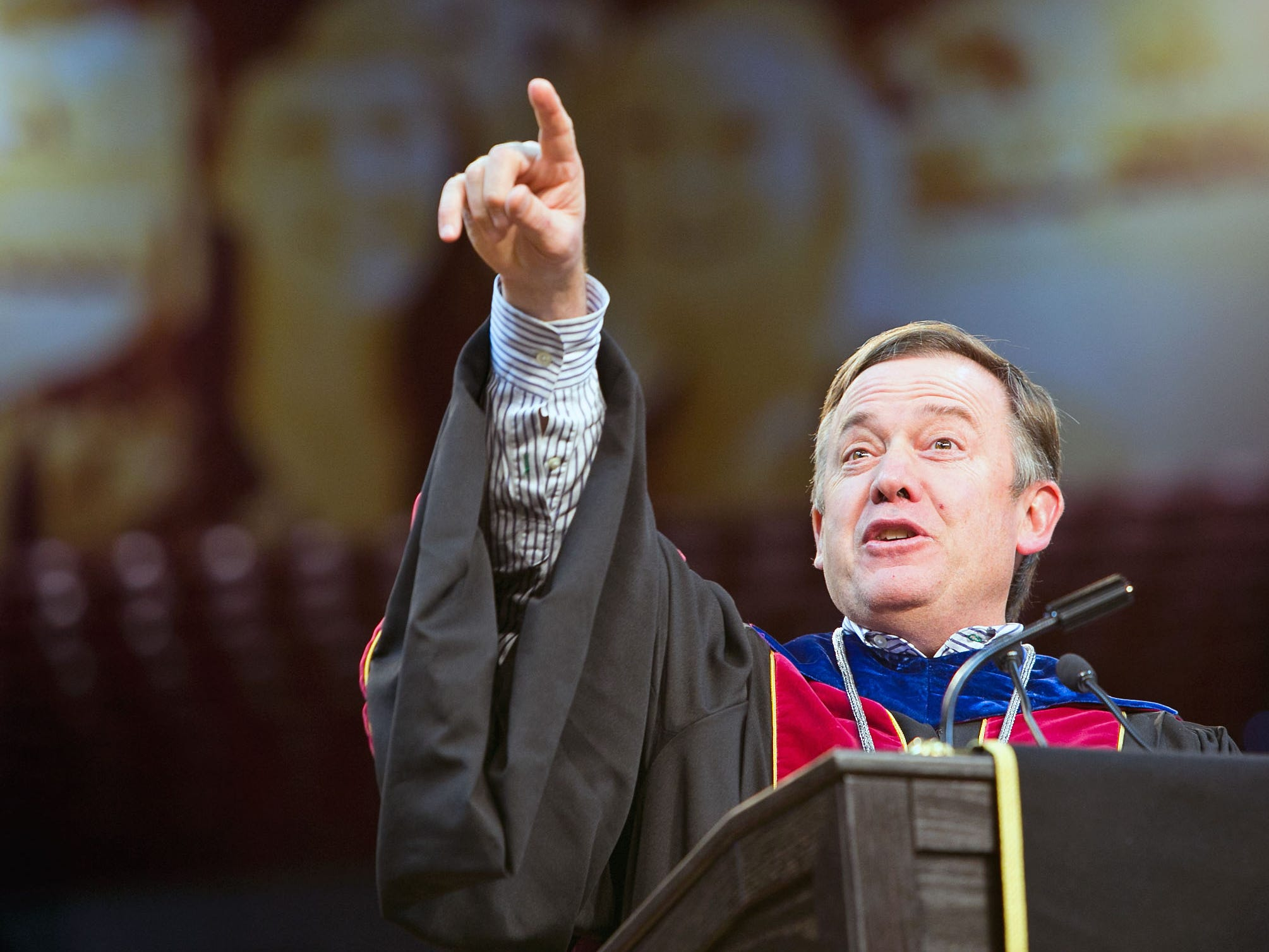 ASU president Michael Crow speaks to graduate students at the 2012 University Graduate Commencement in Tempe.