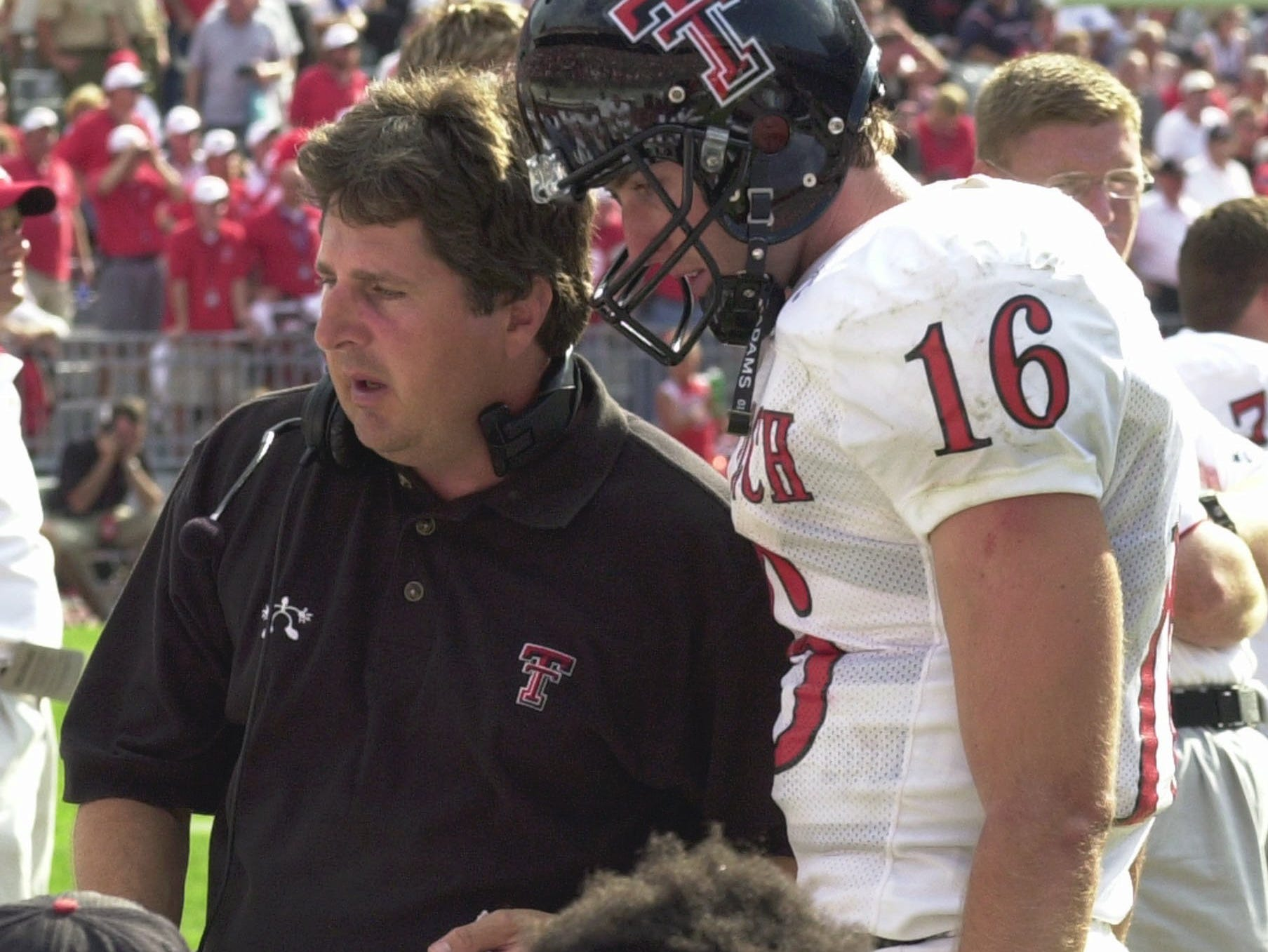 Texas Tech coach Mike Leach talks with quarterback Kliff Kingsbury during the fourth quarter of a 45-21 loss to Ohio State Saturday, Aug. 24, 2002, in Columbus, Ohio.