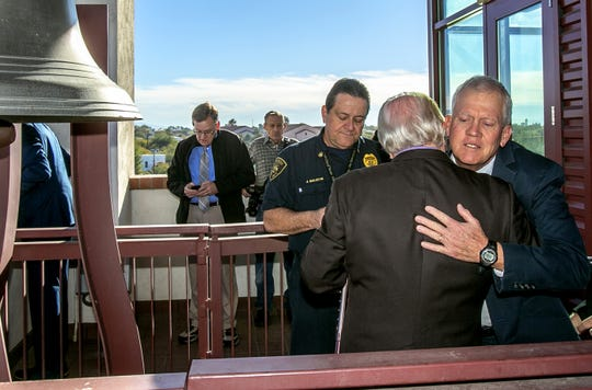 "Ross Zimmerman greets former U.S. Rep. Ron Barber prior to the bell-ringing during a commemoration at Tucson Fire Central on January 8, 2019 in Tucson, AZ. Zimmerman is the father of Gabe Zimmerman, one of six people killed in the Jan. 8, 2011, attack during a ""Congress On Your Corner"" event outside a grocery store. The event marks the eighth anniversary of the attack. This is the first year that names have been read during the event."