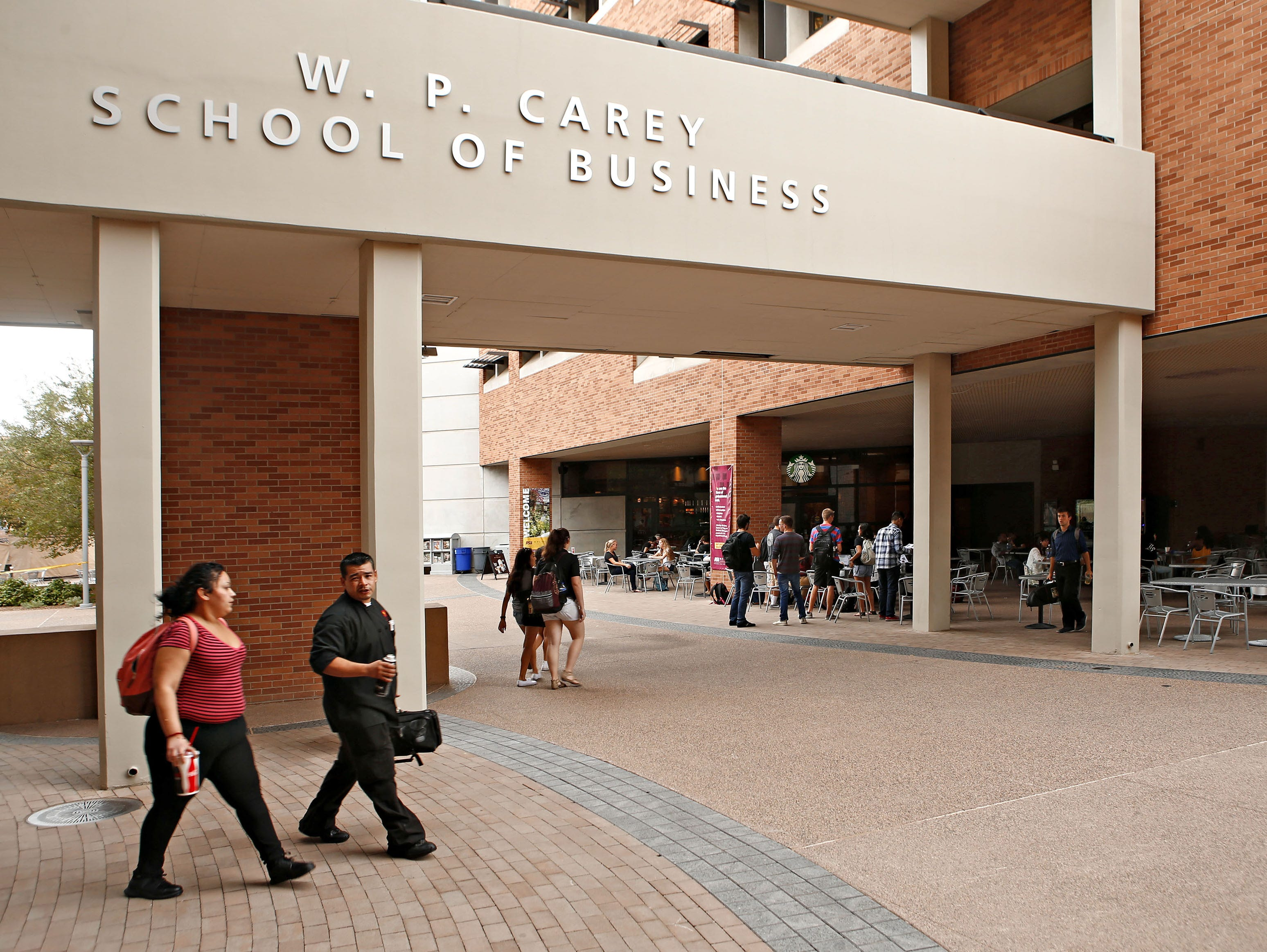 Pedestrians pass The W. P. Carey School of Business at Arizona State University's campus Tempe on Oct. 15, 2015.